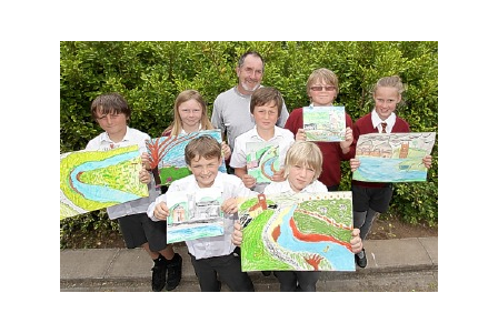 Wadebridge CP School pupils Jack, Lucy, Fergal,  Ewan, Isaac, Bryn and Hannah, with Adrian Langdon, show off their pictures.